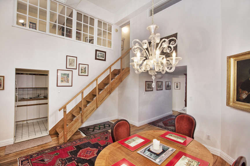 Two bedroom, two full bath condominium with home office in the full-service Printing House.  This stunning, loft-like duplex flows seamlessly.  Upon entry, one's attention is drawn to the spacious, beautifully proportioned dining area and the gracious adjacent kitchen.  Through the dining area, the gallery opens into the dramatic living area with soaring 15 foot ceilings and oversized 11 foot windows.  The second bedroom is situated off the living area, providing the flexibility required should one wish to re-configure this portion of the lower level.  Wonderful wall space for artwork. Simply perfect for entertaining.  Overlooking the living area, the upper level consists of the residence's serenely private master bedroom with en suite bathroom and enormous walk-in closet.  A smart and functional home office is situated off the master suite.  W/D permitted. With its elegant, Italian Renaissance facade, the much sought after and iconic Printing House is centrally located in the West Village across from the James Walker Park.  Convenient to fantastic dining, shopping and transportation, The Printing House is a full service building featuring a full-time doorman, concierge service, on-site valet and laundry facility.  Located at The Printing House, the Equinox Gym is a state-of-the-art exercise facility with a roof top pool and sun deck available to its members. By appointment.