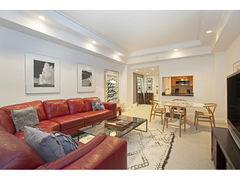 296430492 east 56th street 111 901 living room reverse websized