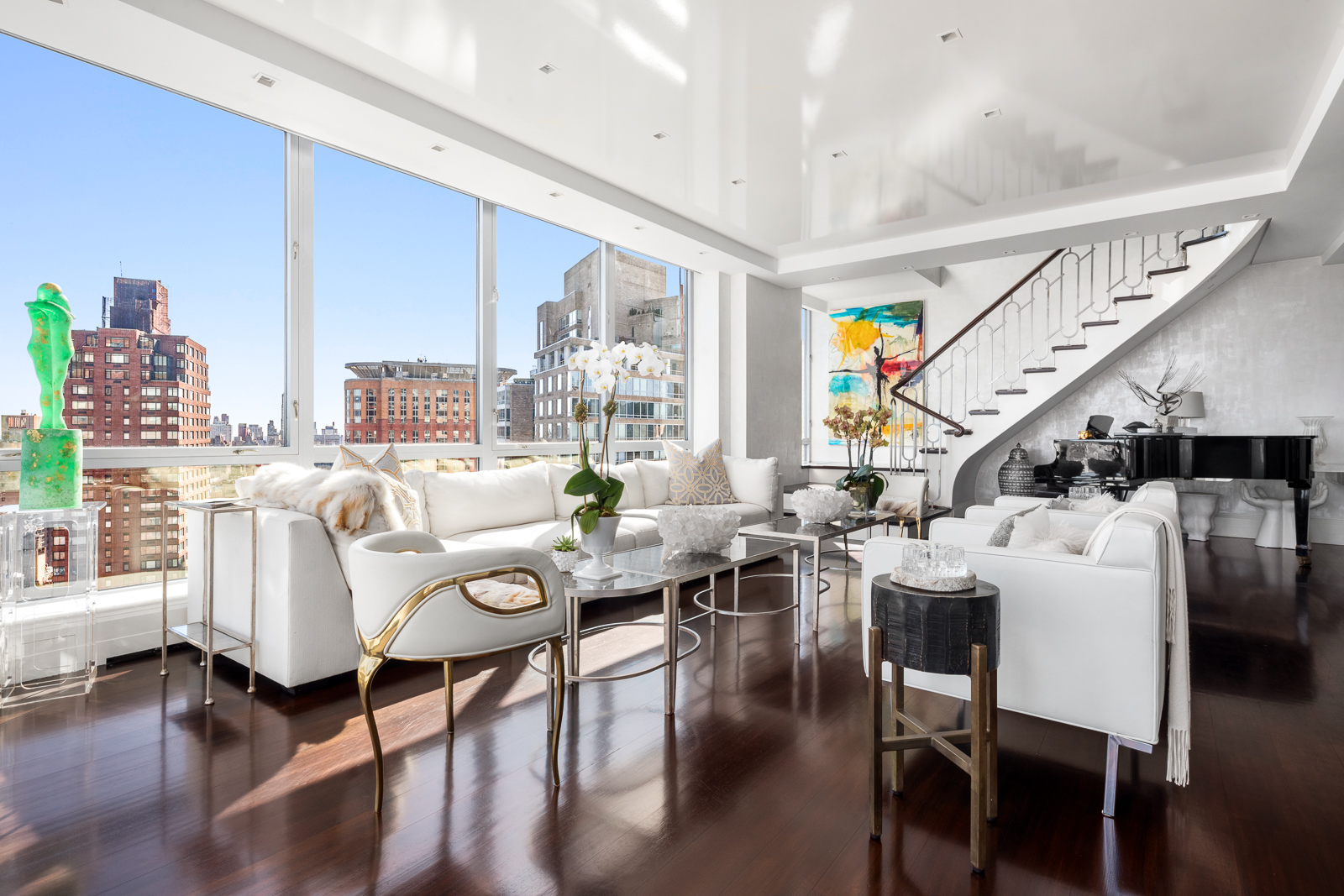 Spectacular, high floor Condominium Apartment with extraordinary, open City and Central Park views. At approximately 4,800 square feet and in mint condition, this beautiful home was renovated to the highest standard and is flooded with light from North, East and South exposures.Enter the Gallery to the Living Room, with Central Park views, and the Formal Dining Room with a double-sided fireplace. The exquisite Wood-Paneled Library or 5th?Bedroom has a full bath en-suite. ?A Peloton and a treadmill are both cleverly hidden here as well.The enormous Eat-in Chef's Kitchen with top-of-the-line appliances provides another warm and wonderful gathering place. ?Off the kitchen is the Laundry Room, with an oversized vented washer/dryer.The dramatic staircase in the Living Room leads to the 2nd?floor and into the glamorous Primary Bedroom Suite, with floor-to-ceiling windows, side Central Park views and a gas fireplace. ?The Primary Bathroom is done entirely in White Onyx with a double vanity, soaking tub and large walk-in shower – a true sanctuary. ?The suite is completed by spacious windowed Dressing Room.The upstairs hallway is lined with closets and leads to 3 additional Bedrooms and 3 additional Bathrooms.No detail was overlooked in designing this magnificent home. ?The apartment features Central AC, a Creston Smart Home System, and seamless and exceptional craftsmanship throughout with marble and mosaic tile.Located in the heart of Lincoln Square, the Grand Millennium provides its residents with a 24-hour doorman, a concierge, and a live-in resident manager. ?Central Park, Columbus Circle, Lincoln Center, Time Warner Center, Equinox Sports Club, upscale shopping and dining are all easily accessible. The building needs 48 hours' notice before appointments. This is a Co-Eclusive with Douglas Elliman.